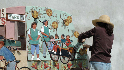 Judith puts up a section of the Immokalee (2007) Mural